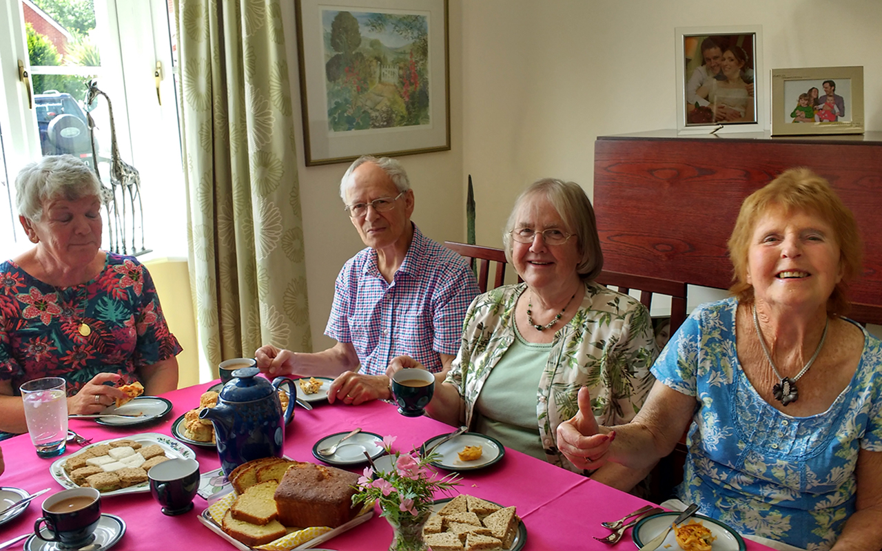 Devizes U3A members around a table with coffee and cake