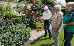 Three U3A women members in Old Rectory garden