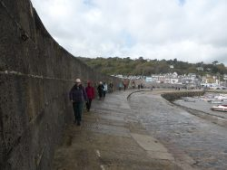Dodging the spray Lyme Regis Cobb extension built of Portland Stone