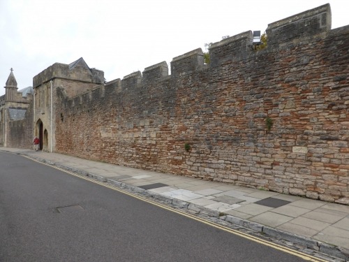 Wall on Cathedral Green Road near Museum of Wells consisting of many types of rock